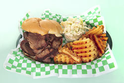 Sparky&#039;s brisket sandwich with waffle fries and coleslaw