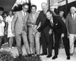 Another day, another shop: Whitman (far right) and others with Neiman Marcus president Lawrence Marcus (far left) breaking new ground in 1969, the company's first store outside Texas
