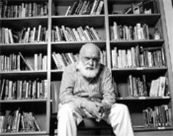 Skeptic James Randi in his library, where intelligent design books are shelved under C for creationism