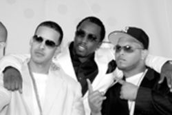It's a hip-hop world: Daddy Yankee (left), P. Diddy, and Daddy Yankee's  MC, Coshee