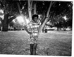 Lola Davis, in her twenties, poses at a Liberty City park