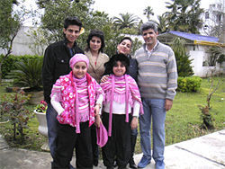 The couple (right) with Gholikhan&#039;s twin daughters and other family members.