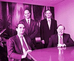 The Fernandez defense team (from left): Steven W. Davis, Gregg H. Metzger, Isaac J. Mitrani, Timothy J. Norris