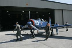 Sax and his buddies roll the CJ-6 onto the tarmac