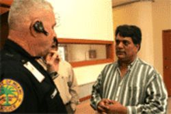 Miami Police Ofcr. Darrell Nichols counsels Camelot Inn  owner Dinesh Paliwal on how to keep his motel open