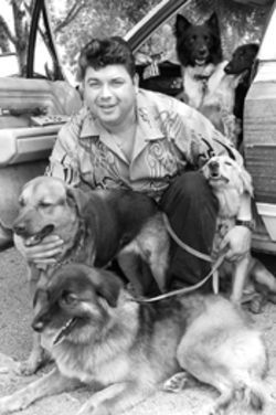 "George Duque experiences the problem known as ""too many dogs"""