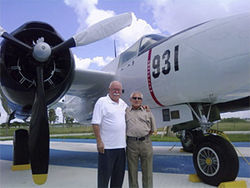 Gustavo (left) and Salvador Miralles with a B-26.