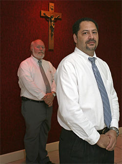 Jay Boutwell (left) and Raymond Scott direct a funeral home in Hialeah.