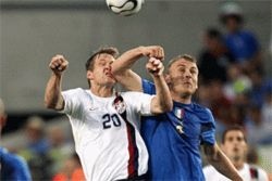 Daniele De Rossi smacks the USA&#039;s Brian McBride in fine Italian fashion