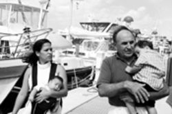 Brigitte Bustamante, toting Daniel, and her husband Donald Diener, 