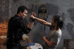 Joe Taslim as Jaka and Yayan Ruhian as Mad Dog in The Raid: Redemption.