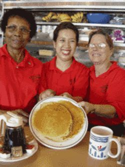 Carrie, Edna, and Shorty flip 'em good at Jimmy's East-Side Diner