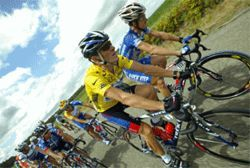 Michael Rogers (right) riding beside Lance Armstrong in the 2003 Tour de France. DeCanio beat Rogers for one stage of a race the previous year. When DeCanio came in second overall, his temper flared