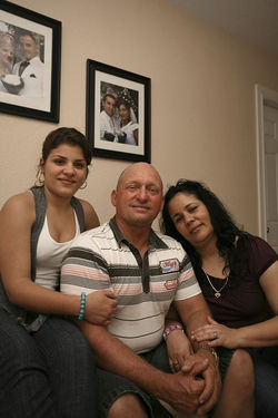 Nelson poses with his daughter Islen and wife Maritza.