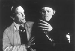 F.W. Murnau (John Malkovich) aims for realism with the star of his show (Willem Dafoe)