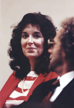 Virginia Larzelere smiles at her defense attorney, Jack Wilkins, during a pause in her 1992 trial.