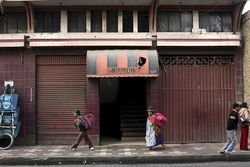 The entrance to José and Mamani's former workplace. Inside, the workshops are barren except for some tables and chairs.