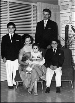 The Alonso family at their home in Cuba; Robert is at right