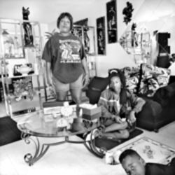 Marilyn Bell, daughter Keyah, and her cousin Dante Larry entertain themselves in Bell's Perrine Gardens apartment