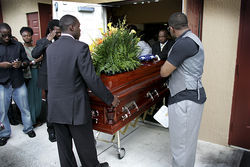 Will&#039;s casket is wheeled out of the church for his final ride to the cemetery.