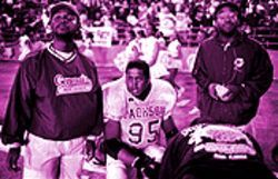 At the Soul Bowl, Frank Gachelin, left, and other Jackson coaches attended to James Dumervil, who injured his knee early in the game