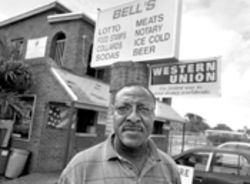 From his grocery store, Wilbur Bell has watched West Perrine weather good times and bad over the past 23 years